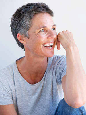 Close up portrait of relaxed older woman smiling